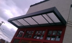 Suspended awnings that rely on hanger rods, support arms, or other overhead support are popular among brick-and-mortar business owners. Our Custom Canvas Works professionals can design custom aluminum suspended canopies that meet your individualized needs.