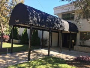 The barrel shape canopy is self-explanatory. This style looks like the top half of a barrel. Because of the flat face on the front, it's a good choice for businesses that want to include a name and/or log on the canopy